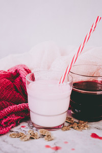Beautiful composition in pink and white of milkshake and red tea