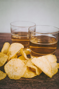 Still life of pale ale beer and chips