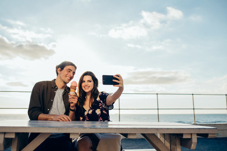 Couple taking selfie on their date