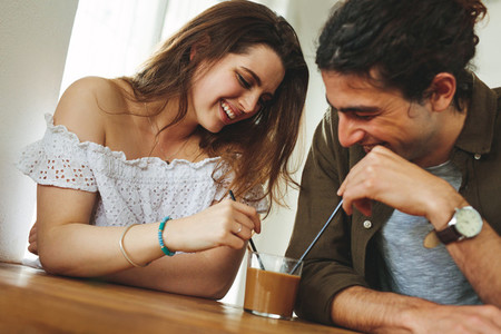 Couple sharing a coffee in a cafe