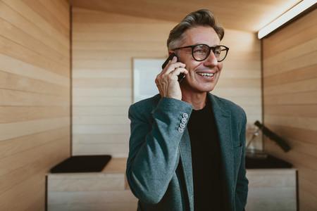Mature businessman talking on phone