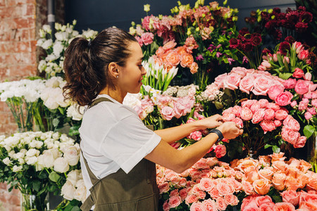 Young woman caring for flowers