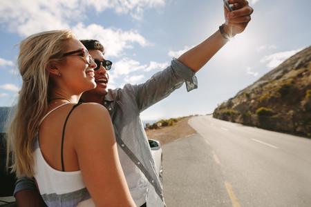 Couple on road trip taking a selfie