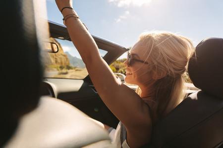 Beautiful woman enjoying on a road trip