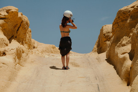 Young redhead woman with a motorbike helmet