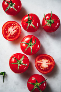 Top view of cherry tomatoes on a white marble tray