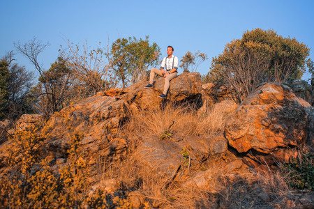 Guy sitting on rocky outcrop
