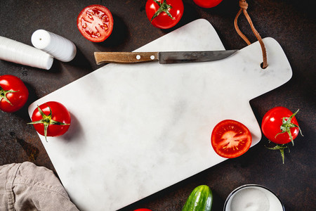 Top view on a white marble tray with fresh cherry tomates Mock up or food background for text