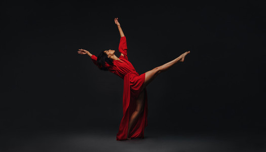 Contemporary female dancer performing on studio