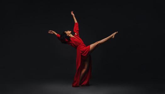 Contemporary female dancer performing on studio