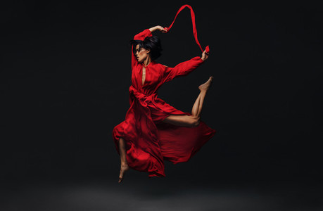 Contemporary female dancer dancing in studio