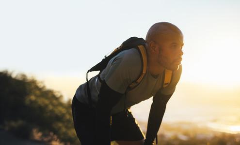 Mountain trail runner resting after a run