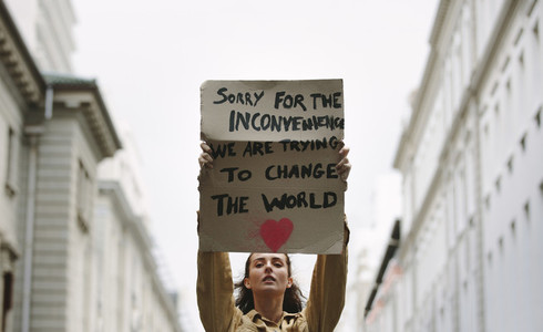 Woman holding poster and protesting