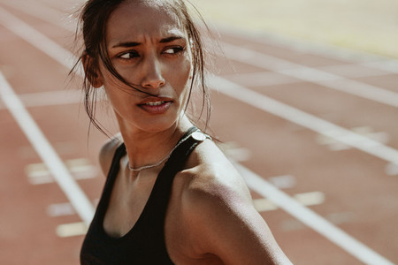 Sportswoman after a run on the stadium track