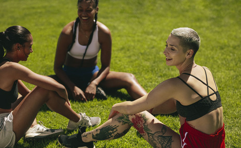 Female soccer players relaxing on the field