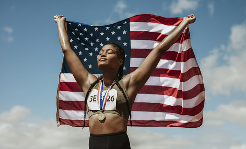 Proud female athlete with USA flag