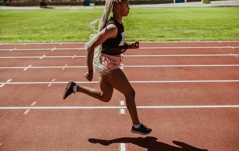 Woman runner training on a running track