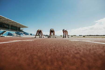 Athletes at starting line on running track