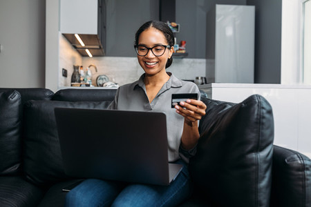 Smiling woman shopping online