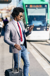 Black Businessman waiting for the next train