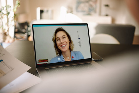 Businesswoman on a video call with her colleague