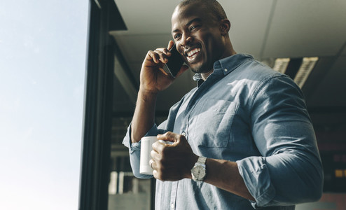 Smiling businessman talking on phone