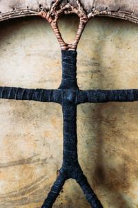 Details of shamanic tambourine  Leather braided handle  handmade  close up view