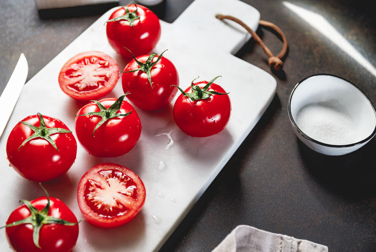 Cherry tomatoes on a white marble tray
