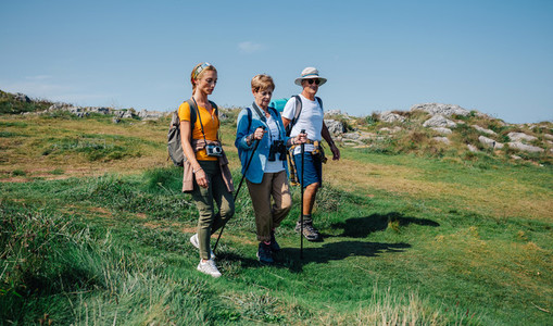 Family practicing trekking together outdoors