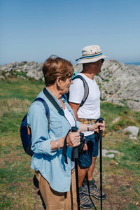 Senior couple practicing trekking outdoors