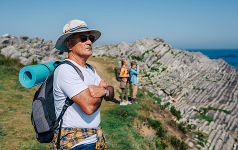Senior man trekking looking at the landscape