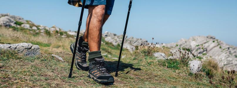 Senior man practicing trekking outdoors