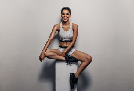 Fit woman relaxing after exercising