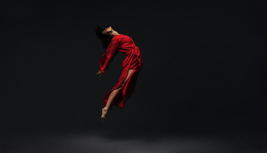 Contemporary dancer dancing on studio background
