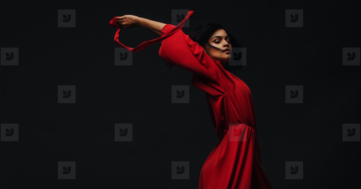 Beautiful woman dancing in studio