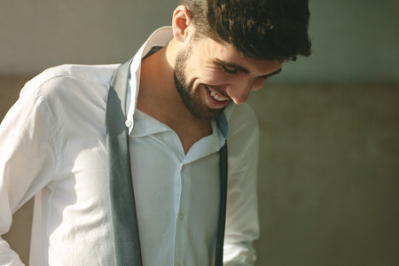 Smiling man getting dressed for office