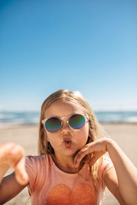 Cute girl in sunglasses making a funny face