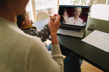 Woman having a video call with her mother