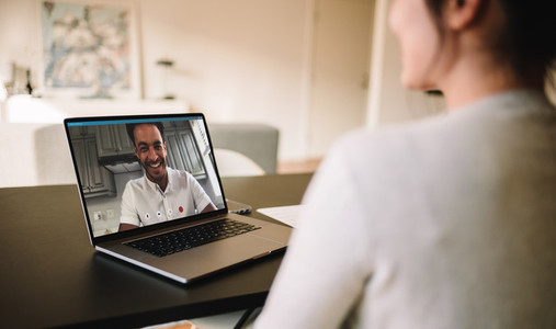 Couple having video call on laptop