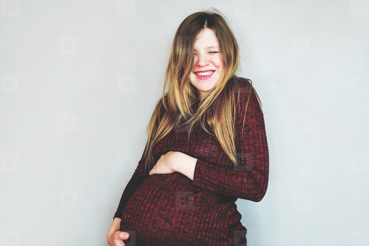 Really happy young pregnant woman