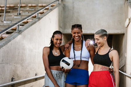 Woman soccer players with a ball at the stadium