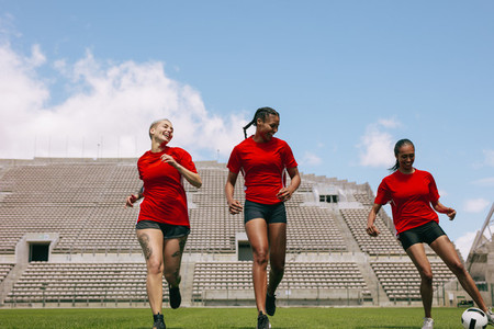Female football players training on soccer field
