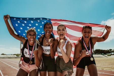 Group of athletes celebrating winning gold