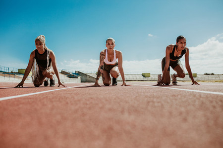 Sprinters at starting blocks ready for race