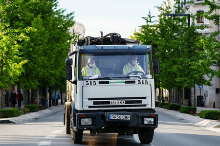 GRANADA  SPAIN  23RD APRIL  2020 Garbage truck driving on the empty street
