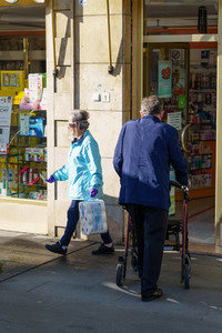 GRANADA SPAIN 23RD APRIL 2020 Older people shopping at the pharmacy  protected by masks