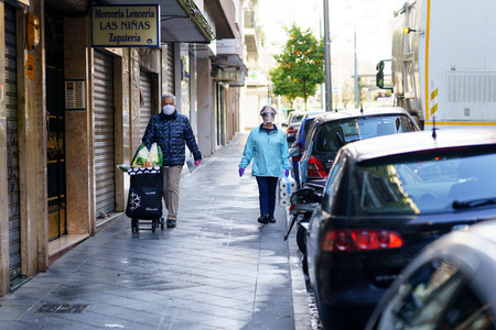 GRANADA SPAIN 23RD APRIL 2020 Older people shopping protected by masks  during the Covid 19 pandemic