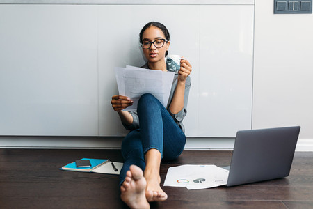 Woman looking on documents