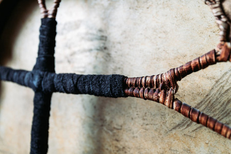 Details of shamanic tambourine  Leather braided handle  handmade  close up view