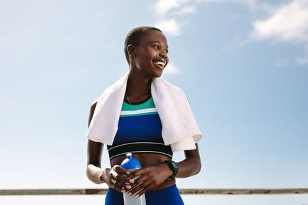 Sportswoman taking break after workout session